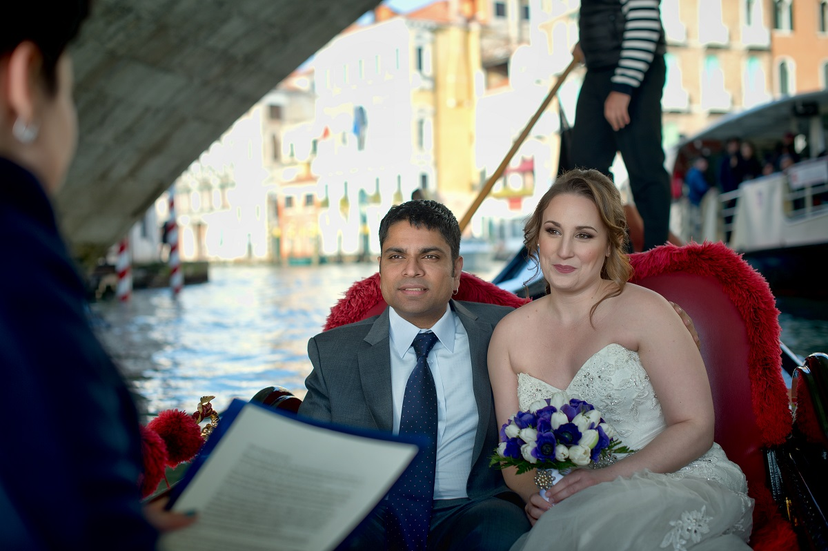 Spouses on a Gondola having their symbolic ceremony during an Elopement