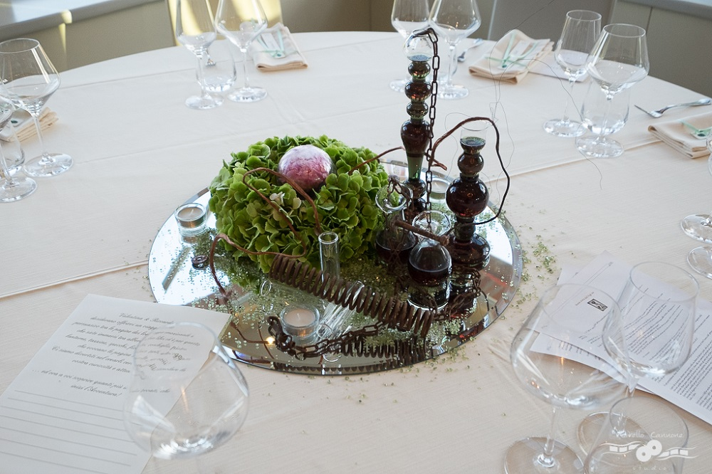 Frankenstein inspired centerpiece with test tubes and mysterious substances on a round mirror
