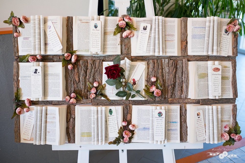 A tableau de mariage made with victorian literature on a piece of tree bark