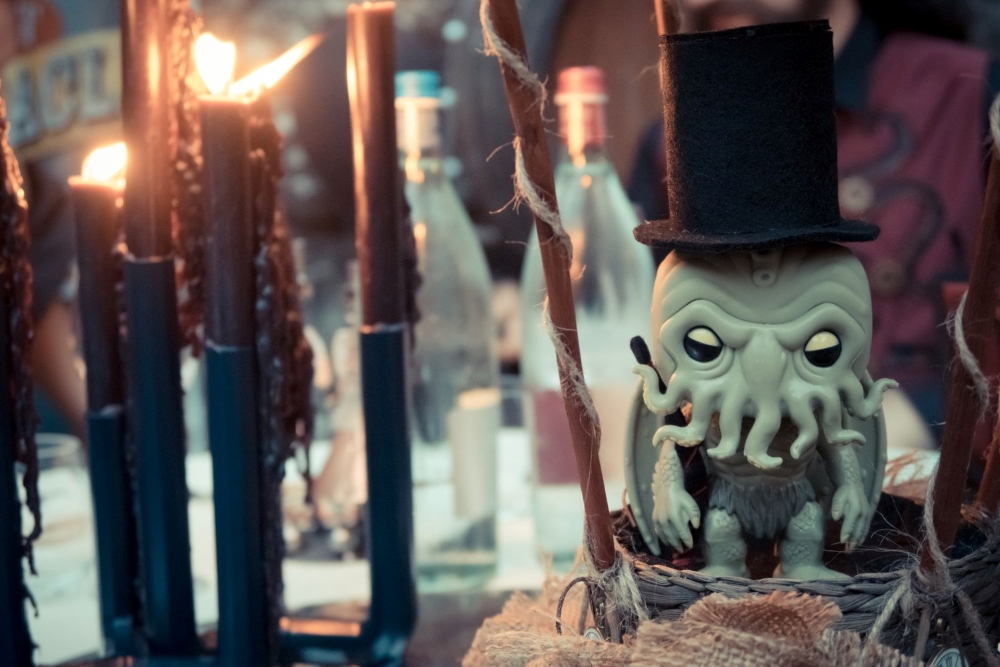 A table centerpiece with a cute version of H.P.Lovecraft's Chtulhu with black candles