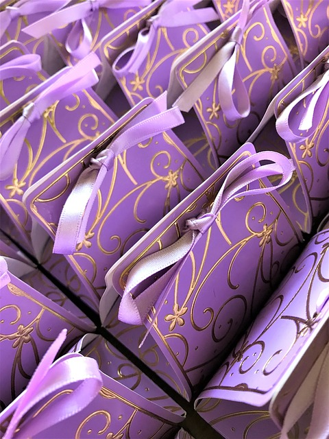 Purple wedding bags with gold decor and purple bow