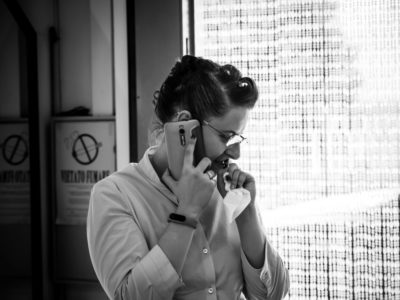 Black and White photo of a thoughtful woman in profile while she's at the phone