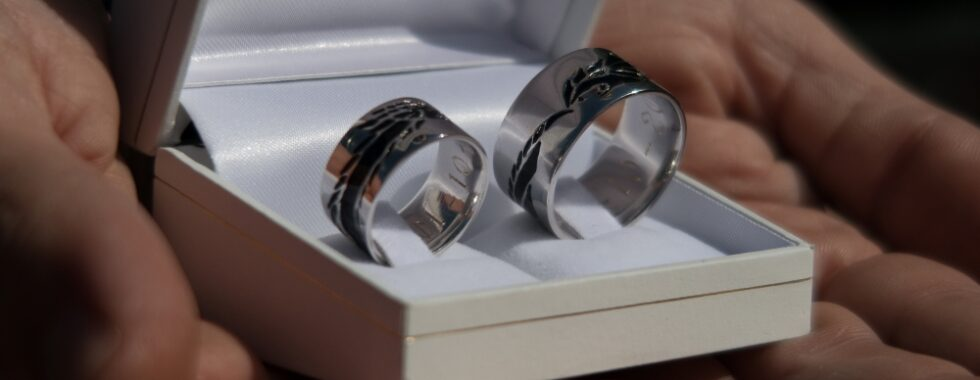 White gold wedding bands with dragon engraved and filled with black enamel