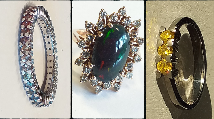 On the left, a rainbow-coloured ring (with multicoloured sapphires) in white gold with heart-shaped grafts, At the centre, a ring with a big green/reddish gem, diamonds and yellog gold, on the right a black gold trilogy ring with yellow diamonds