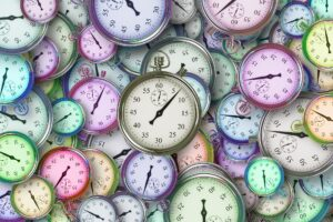 A lot of clocks, reminding the busy woman that the time is ticking!